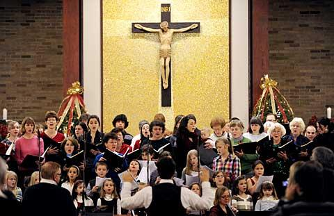 St. Joseph choir members perform Jan. 8.