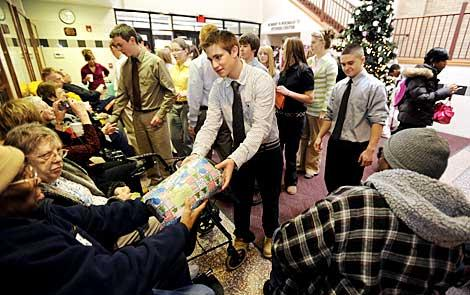 Matt Ricigliano helps hand out gifts Dec. 9.