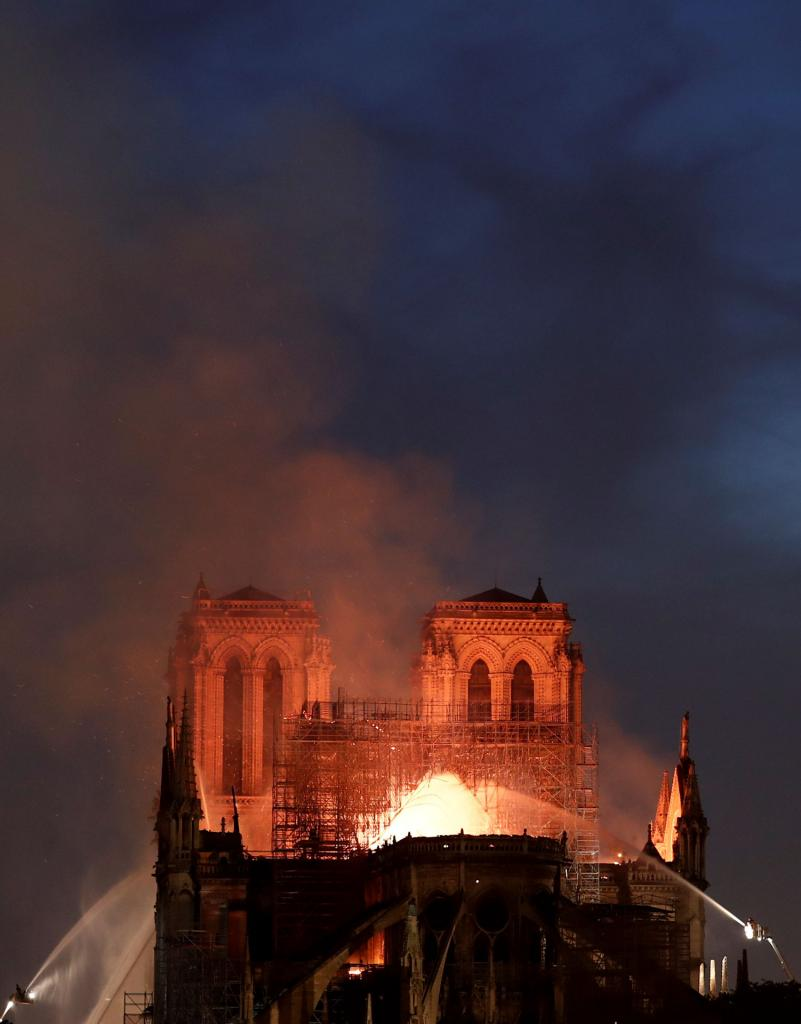 Flames and smoke billow from the Notre Dame Cathedral after a fire broke out in Paris April 15.(CNS photo by Benoit Tessier, Reuters)
