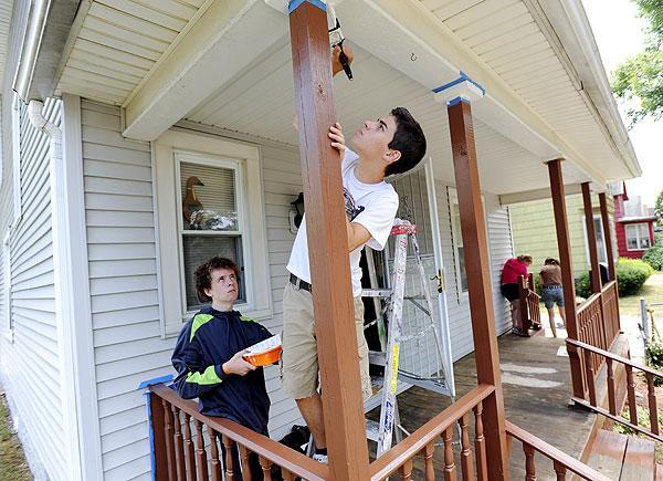Paul Flagg of Bedford, Va. paints the porch.