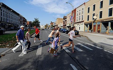 Students race across Main Street in Canandaigua.