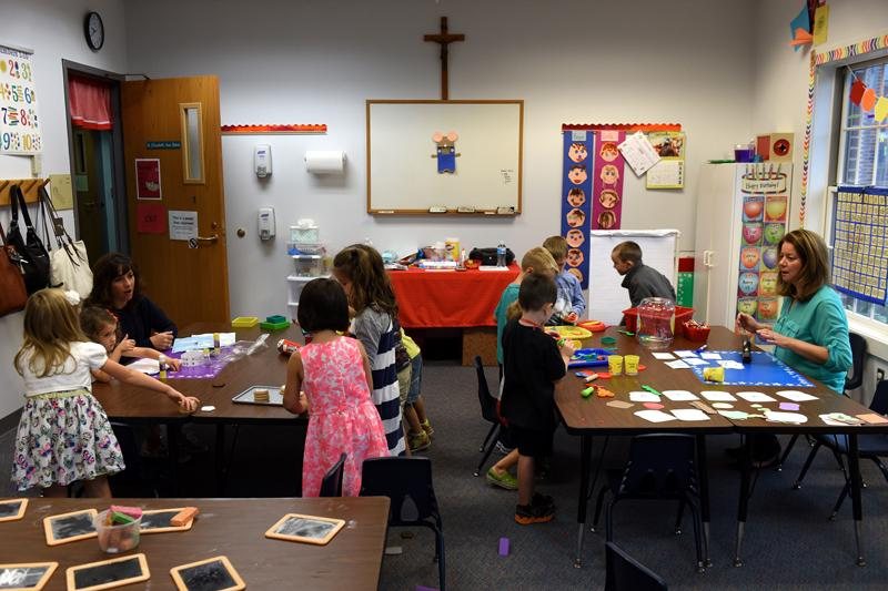 Children are busy with teachers Stephanie Already, left, and Lisa Hannel at St. Patrick's Preschool is located in the preschool wing of St. Patrick Church's parish hall in Victor Sept. 23.