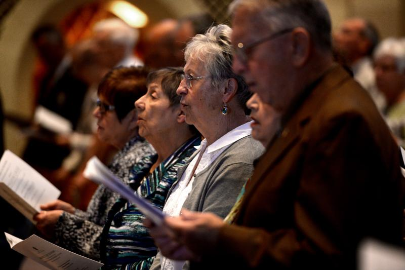 Parishioners sing during the Diocesan Respect for Life Mass honoring 20 years of Project Rachel ministry at Sacred Heart Cathedral Sunday, Oct. 2.