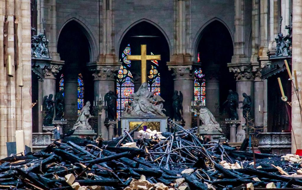 Debris surrounds a depiction of the Pieta by Nicolas Coustou in Notre Dame Cathedral April 16. (CNS photo by Christophe Petit Tesson pool via Reuters)