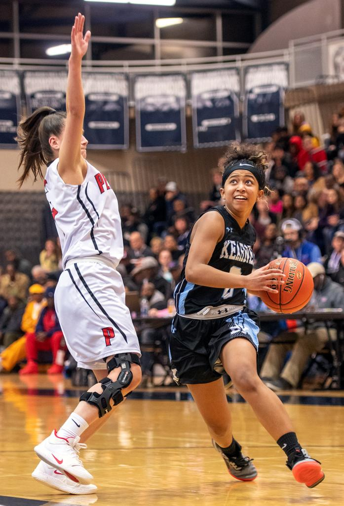 Bishop Kearney's Marianna Freeman drives to the basket past Penfield's Baylee Teal in the Section 5 Class AA girls' basketball championship March 6 at Gates Chili High School.
