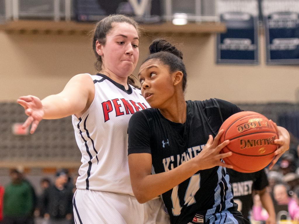 Bishop Kearney's Camille Wright drives the ball past Penfield's Jessica Renere.