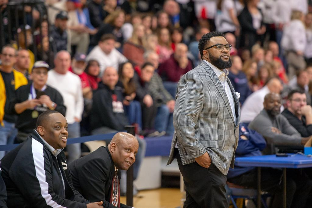 Bishop Kearney coach Kevan Sheppard watches the game in the second half.