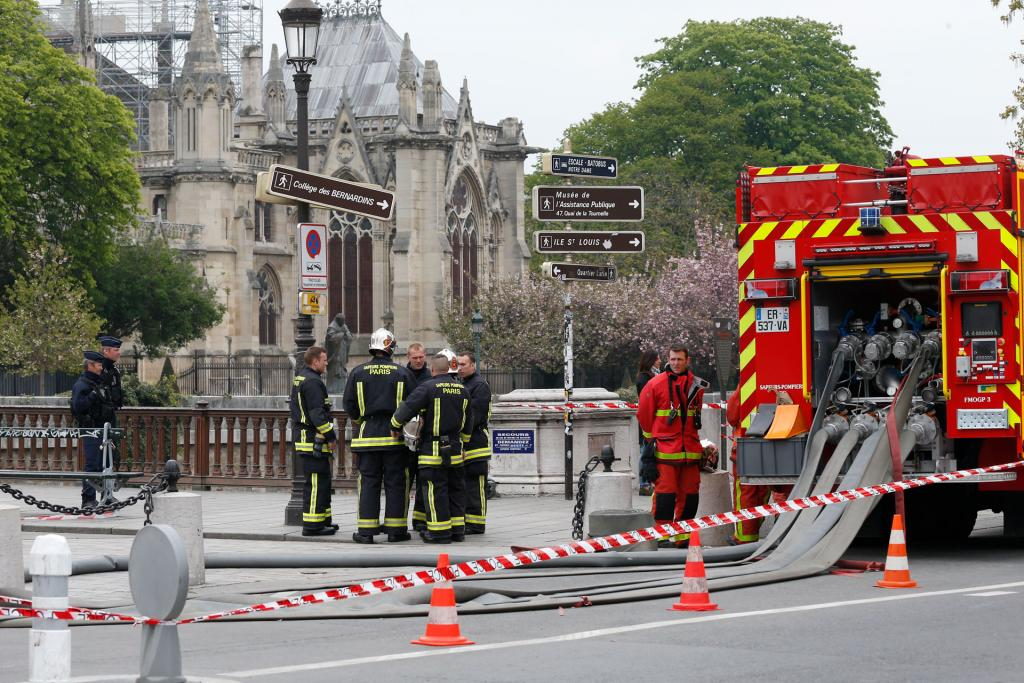 Firefighters are seen in front of Notre Dame Cathedral April 16. (CNS photo by Paul Haring)