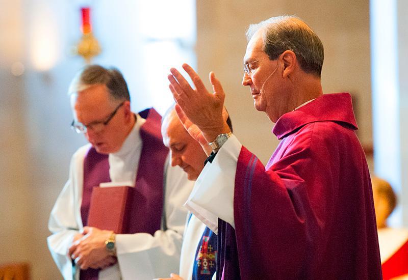 Father Edward Salmon celebrates Mass.