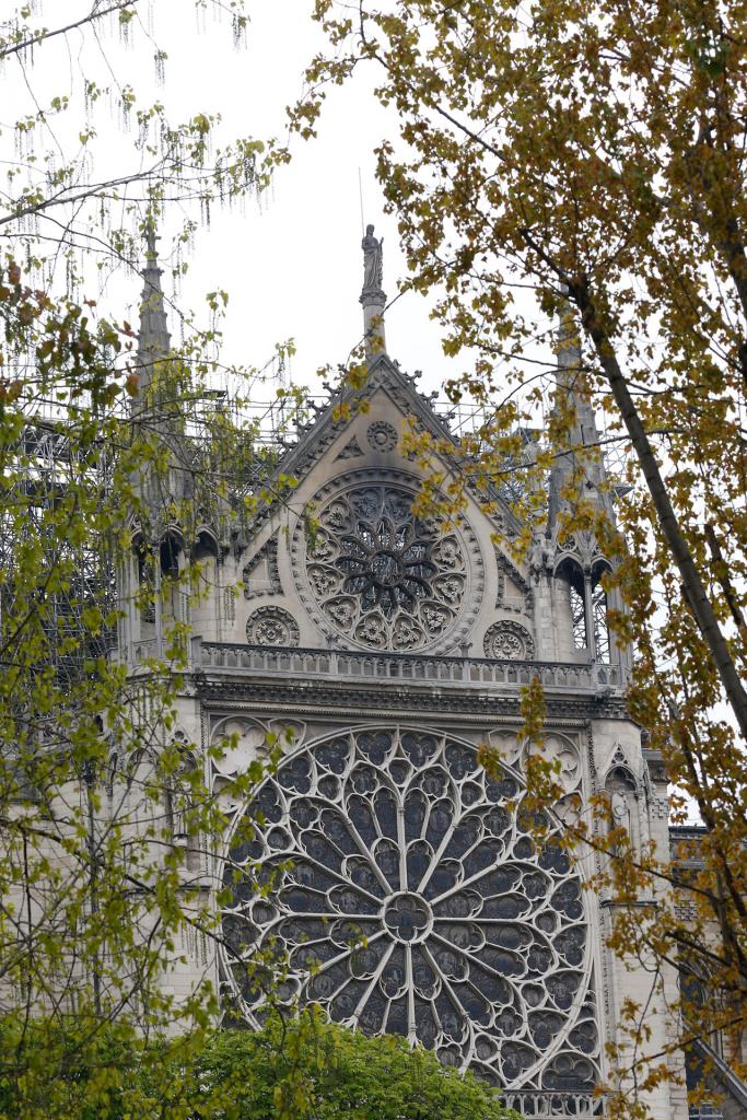 One of the rosette windows of Notre Dame Cathedral is seen scorched April 16. (CNS photo by Paul Haring)