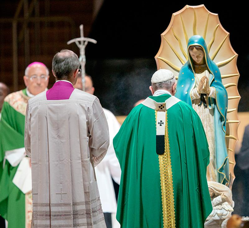 Pope Francis incenses a statue of Our Lady of Guadalupe at the start of Mass at Madison Square Garden.