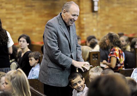 Bishop Matthew H. Clark meets students before the Mass.