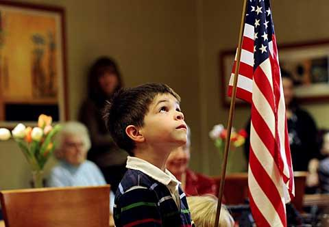 Liam McCormack and his classmates sing a patriotic song.