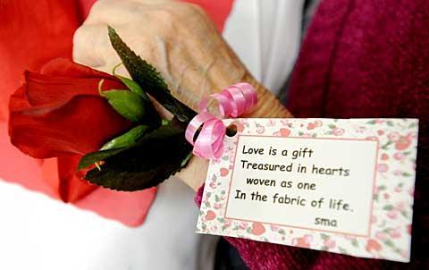 Rose Gangi wears a love poem and silk rose around her wrist.