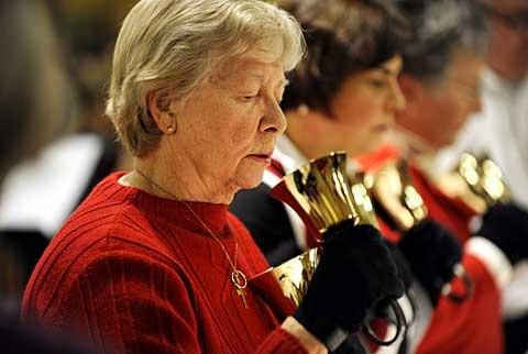 Barbara Rice performs with the handbell choir.