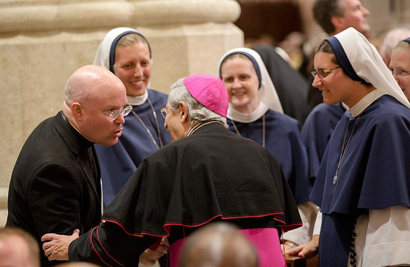 Bishop Salvatore R. Matano greets a group of nuns and a priest in attendance prior to the evening prayer service at St. Patrick's Cathedral.