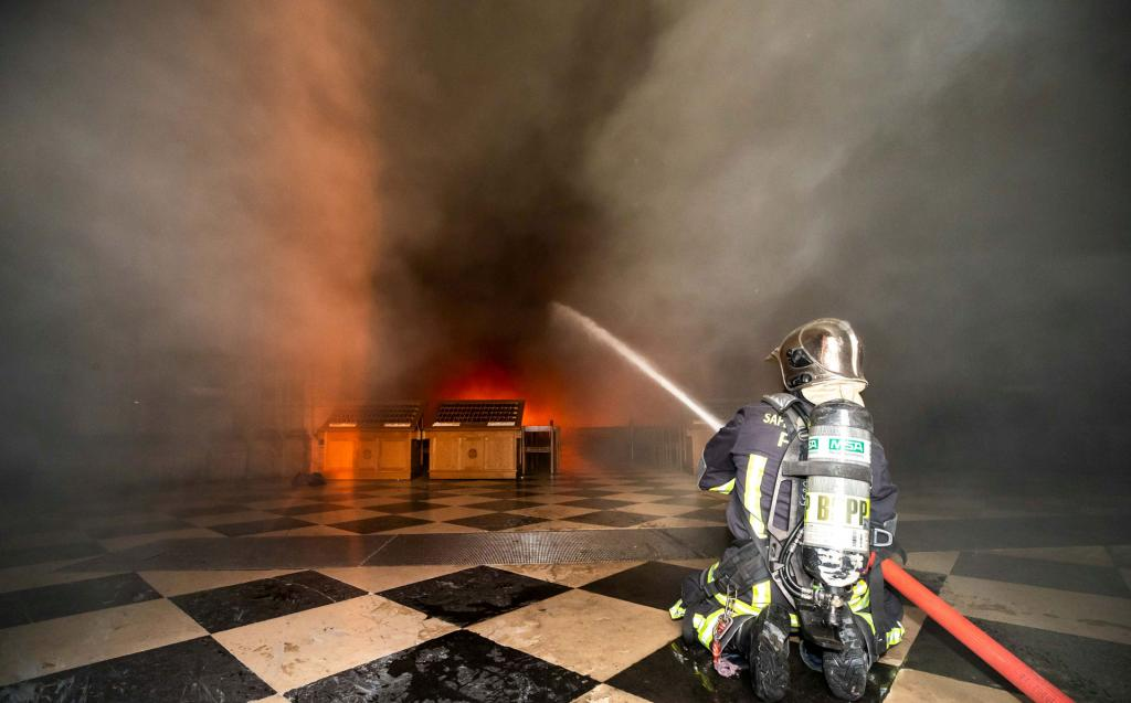 A firefighter battles flames inside Notre Dame Cathedral after a fire broke out in the iconic Paris structure April 15. (CNS photo by B.Moser©BSPP handout via Reuters)