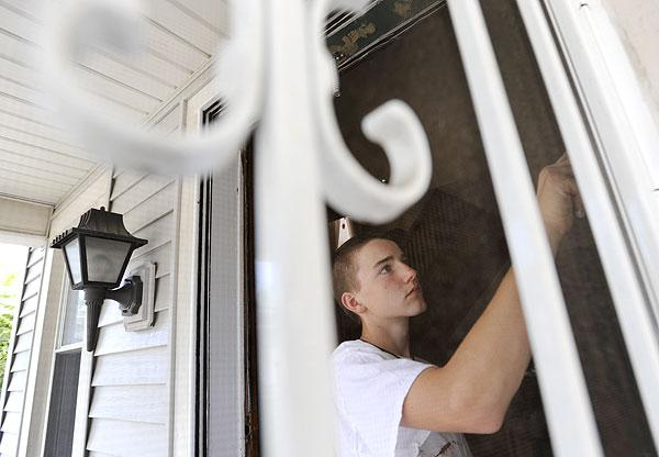 Jacob Criste of Bedford, Va. works on the front door.