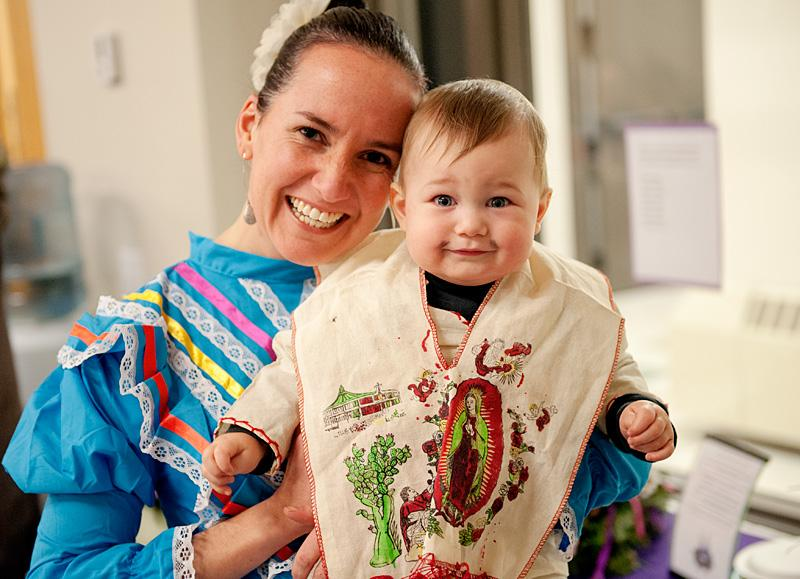 Diana Chapoy Callahan and her 1-year-old son Ian, dressed as St. Juan Diego, pose for a photo.