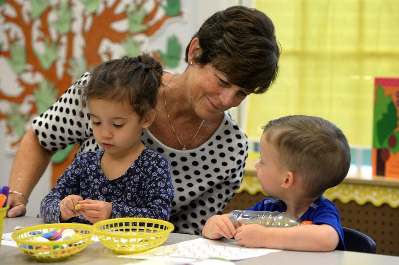 Teacher Marcie Hamilton works with Ford, right, and his sister, Emma, at St. Patrick's Preschool is located in the preschool wing of St. Patrick Church's parish hall in Victor Sept. 23.