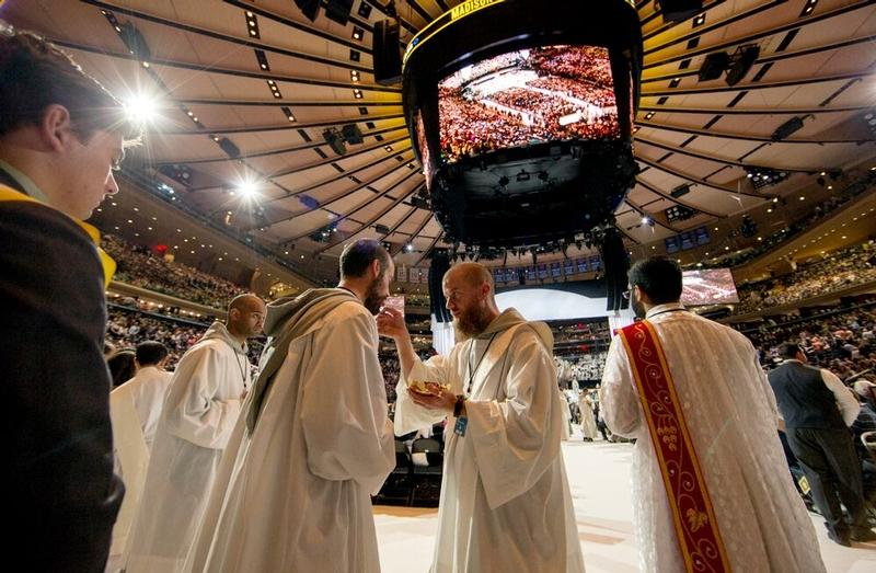 Communion is distributed during Mass at Madison Square Garden in New York Sept. 25.