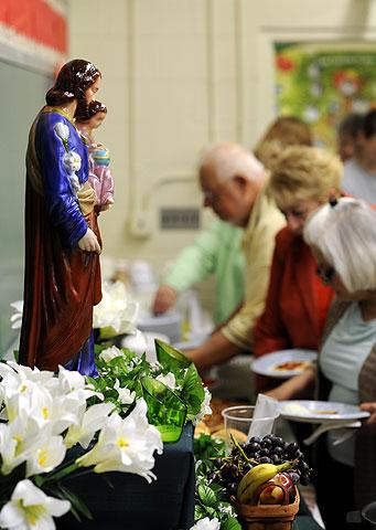 A statue of St. Joseph stands on the table.