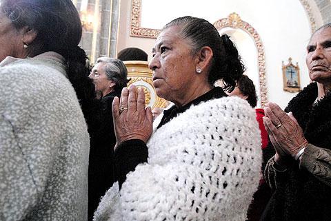 Communion during Mass at Santuario de los Remedios Church.