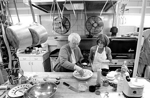 Joyce Zmuda (left) and Marie Leo prepare food.