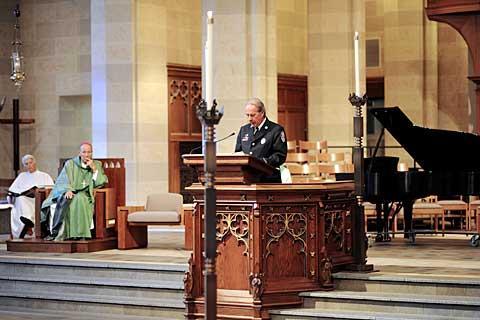Rochester Fire Dept. lieutenant John Appleby reads a prayer.