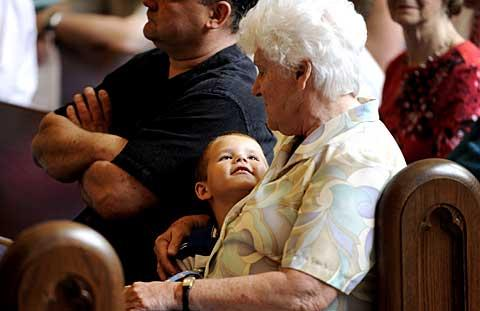 Zachary Rowe looks up at his grandmother, Mary Ann Mulhern.