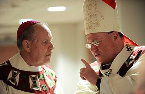 Bishop Clark and Archbishop Dolan talk prior to the Mass.