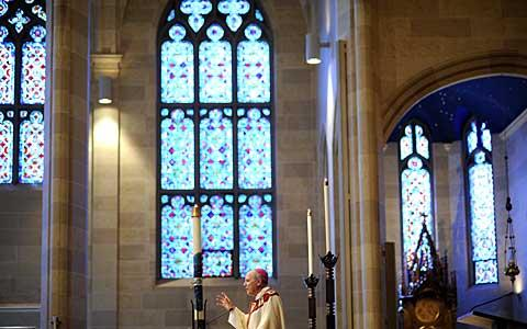 Bishop Matthew H. Clark delivers the homily during the Mass.