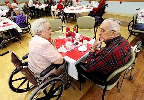 Grace Pikul (left) and her husband Larry talk over a cup of tea.