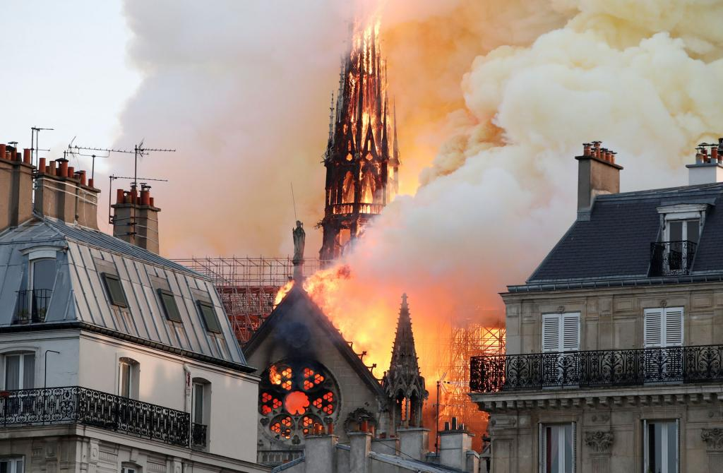 Flames and smoke billow from the Notre Dame Cathedral after a fire broke out April 15. (CNS photo by Benoit Tessier, Reuters)