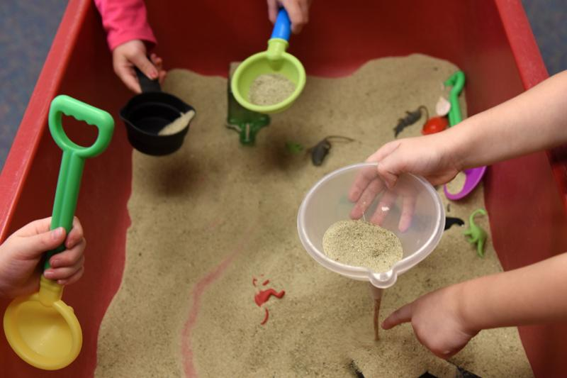 Kids play in the sand box at St. Patrick's Preschool is located in the preschool wing of St. Patrick Church's parish hall in Victor Sept. 23.