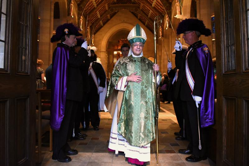 Bishop Salvatore R. Matano walks through a Knights of Columbus honor guard after celebrating the Diocesan Respect for Life Mass honoring 20 years of Project Rachel ministry at Sacred Heart Cathedral Sunday, Oct. 2.