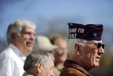 Korean War veteran Vic Vinkey helps read names.
