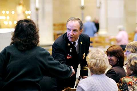 Rochester Fire Chief John Caufield attends the Mass.
