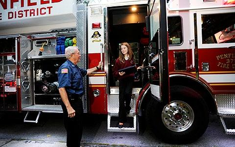 Joan takes a look inside the fire truck.