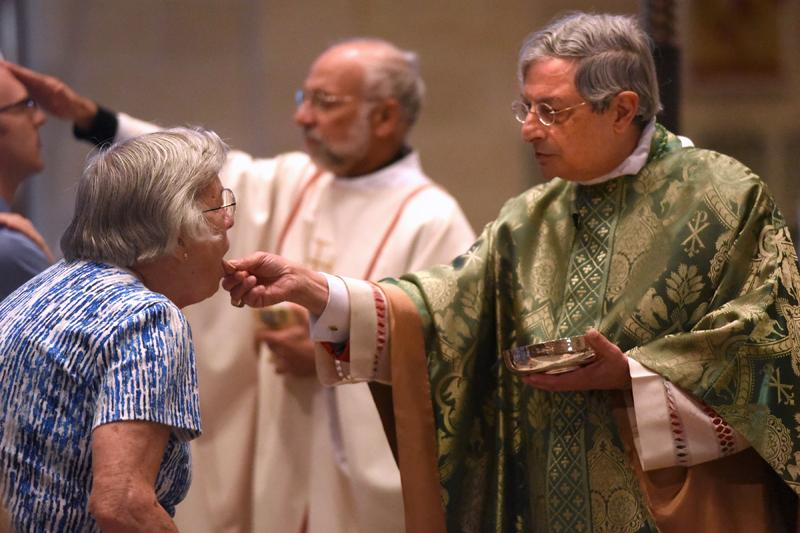 Bishop Salvatore R. Matano gives communion during the Diocesan Respect for Life Mass honoring 20 years of Project Rachel ministry at Sacred Heart Cathedral Sunday, Oct. 2.