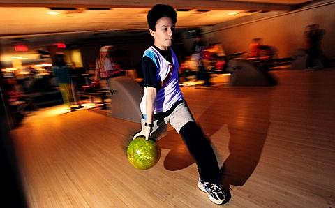 David Tomer makes his approach Feb. 3 at Empire Lanes.