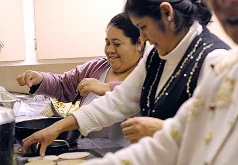 Paz Mesa helps prepare traditional Mexican fare.