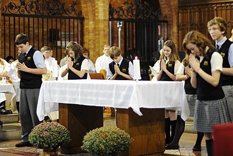 St. Mary students sing a song at the altar.