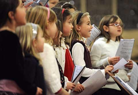 The St. Joseph Children's Choir performs.