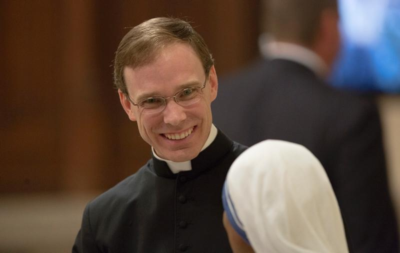 Father Daniel White talks to a nun as he waits for an evening prayer service with Pope Francis to begin at St. Patrick's Cathedral in New York Sept. 24.