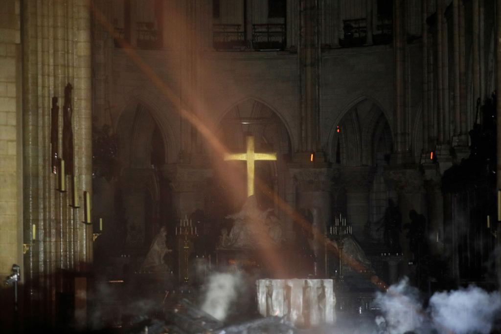 Smoke rises around the altar in front of the cross inside the Notre Dame Cathedral as a fire continues to burn April 16. (CNS photo by Philippe Wojazer, Reuters pool)