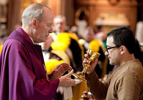 Bishop Emeritus Clark offers Communion.