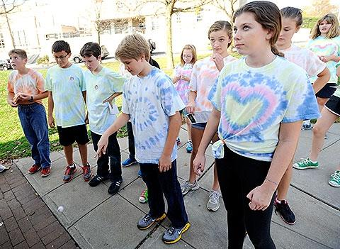 Students stop to play a challenge game.