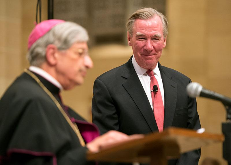 CUA President John Garvey smiles as he is introduced by Bishop Salvatore R. Matano at the start of the lecture.