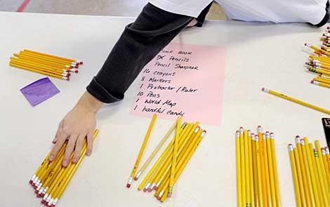Students organize pencils for care packages.